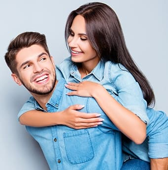 Teeth Whitening - young couple in denim